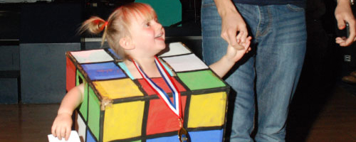 Child dressed as rubics cube